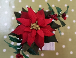 Poinsettia and holly wired arrangement